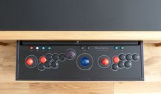 The evolution of our arcade table control panel - Sanwa sticks and buttons, Happ illuminated trackball and Ultimarc spinner.