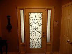 BRISTOL WROUGHT IRON GLASS DOOR INSERT. INSTALLED IN COLLEGE MANOR IN NEWMARKET ONTARIO