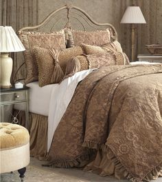 Sculpted and cascading in form, richly textured and monochromatic, Sonia embodies the notion of extravagant artistry. Ruffles, tassels, and a floral brocade main fabric will transform the master bedroom from a place to sleep into a vision of grace. By Eastern Accents