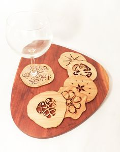 This set of six coasters has been laser cut from amber-colored bamboo ply. Each set includes six different silhouettes derived from the shapes - designerica Etsy Types Of Fruit, Fruit And Veg, How To Tie Ribbon, Fruit Slice, Cnc Projects, Wine Charms, Scroll Saw, Dremel, Laser Engraving