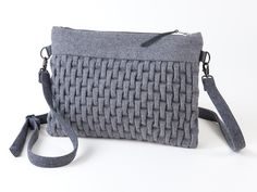 This handbag is handmade in Copenhagen and the decoration is hand sewn with the embroidery technique called Smocking. The technique has been used for centur