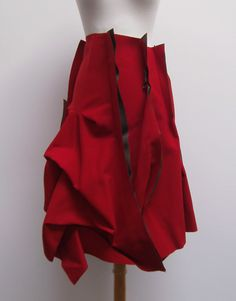 Rundholz red architectural skirt with olive accents. very sculptural.