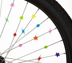 Saw bicycle wheels of different sizes hanging on a wall as picture/card/memory holders. Bed, Bath  Beyond super expensive. Old bikes in ur garage uuumm, FREE. Just Saying. Very MO-dern.