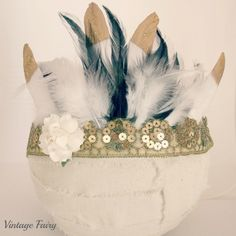 Loving this stunning glitzy glam feather crown made with sequin lace with lots of beautiful soft feathers.Featuring white gold tipped feathers. Perfect accessory for a photo shoot, a wedding, a gatsby dress up party, 1950's party. Made to fit newborn to adults, please choose in the drop down list. Adults size has a $3.00 extra charge as I make them with more feathers