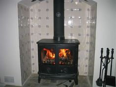 Woodburning stove with delft tiled backdrop