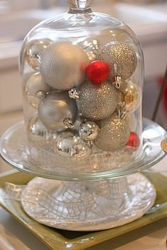 Lots of inspiration for decorating on a dime. Such an easy and inexpensive idea - Use cloche for Christmas