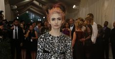 Grimes?  Her name is very appropriate. No idea who she is, but she looks really pissed...probably at her stylist or designer.