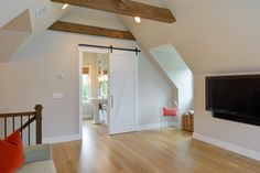 Open space over garage with custom beams and full bathroom.  A perfect place to create additional multi-use living!