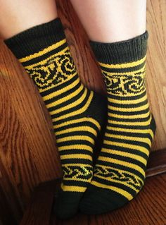 Ravelry: larkspur91's Vellamo Socks, WI Style ... pinning for the bold color contrast and combination of stripes and stranded colorwork