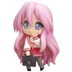 This... is a Nendoroid. AKA, pocket-change drain. Yeah, I like chibis... I think they're cute, and Nendoroid are chibi figures that pose and come with different faceplates. I love them.