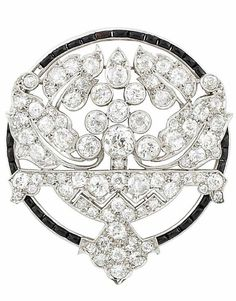 Platinum, Diamond and Black Onyx Brooch  Centering a stylized bouquet atop a table, set with 81 old-mine and single-cut diamonds approximately 4.70 cts., within a black onyx circle, circa 1925, approximately 9 dwts.