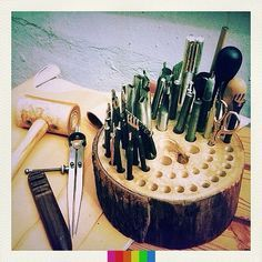 Love the look and it's FREE! Just a slice of a tree with multiple holes drilled in deep enough to hold items. Good way to organize paint brushes and another for fancy pens and colored pencils.