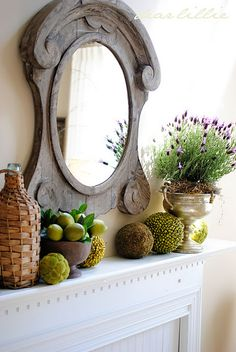 This is lovely.  Love the trophy cup / planter, moss balls, and the mirror is so unique.