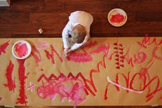 Perfect holiday project! Let kids paint a giant roll of kraft paper to use as gift wrap. The end result is prettier than you'd think!