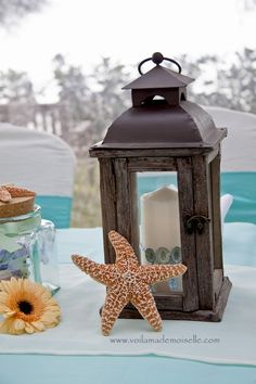 beach theme decoration - these would be pretty in between your flowers, with starfish, shells scattered  throughout- lit when it gets to be dusk