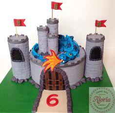 Dragon guarding the castle birthday cake