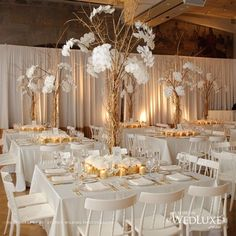 Love these centerpieces! Really want to go with a gold branch theme and these are incredibly dramatic.