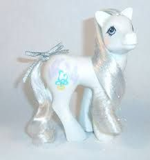 A white earth sister pony with white and irridescent tinseled hair. Doves and rings as a symbol. A year 8 Pony. Vintage My Little Pony, Symbols, Bride, Disney Princess, Disney Characters, Pretty, Haku, Year 8, Mlp