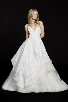 Style 6550 Behati / Ivory geometric organza bridal ball gown, draped V-neck bodice and Moroccan beaded back, full skirt with pick up detail and tiered tulle underlay.