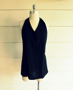 Looking for a halter top for the beach or the hot summer days.    Here is one you can make in minutes out of a tee-shirt, without any sew...
