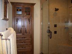 TRADITIONAL MASTER BATH- custom linen closet, frameless shower doors.
