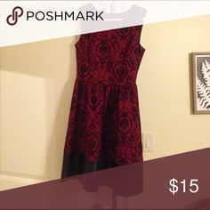 Von Maur Dress.  Perfect condition. Perfect condition. Maroon/black. Polyester / %5 spandex.  Fits 4-6. Slightly above knee length. Soprano Dresses High Low