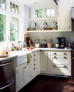Suzie: Anne Coyle Interiors - Small chic coastal cottage kitchen design with creamy white ...