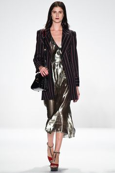 Reviving last season's disco trend with a lame dress but marrying it with this season's continuing menswear look makes this Rebecca Minkoff look a sharp winner on the runways and your next dinner party.  Rebecca Minkoff Fall 2014 Ready-to-Wear Collection Slideshow on Style.com