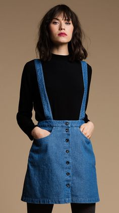So sweet and 60's we couldn't help but make this Jumper for Fall! Made from washed denim, the Peggy Jumper features front pockets, button front placket and cross back straps. Waistband sits at natural