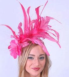 Wearing pink for the Oaks Race in Kentucky in a Neon Pink Feather Fascinator by HAT-A-TUDE.COM