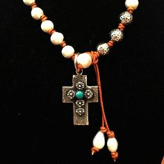 Our cross on a Tracy Russo pearl necklace