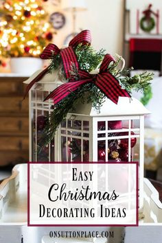 Easy Christmas Decorating Ideas | Festive, Fun & Fast | DIY inspiration for decorating your home for the holidays on a budget. Lanterns on coffee table with greenery and ribbon bows.