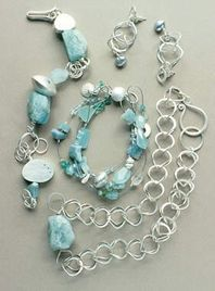 Two aquamarine and silver bracelets.