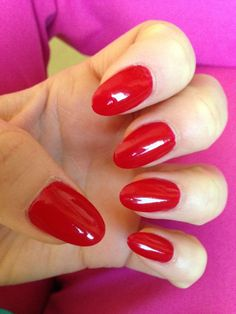 Million dollar red oval shape nails.