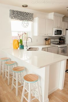 Spring Parade of Homes - White Kitchen with Pops of Color- corner sink- Corner Sink Kitchen, Kitchen Layout, Kitchen Design, Kitchen Decor, Kitchen Ideas, Parade Of Homes, Bad, Decoration, Home Kitchens
