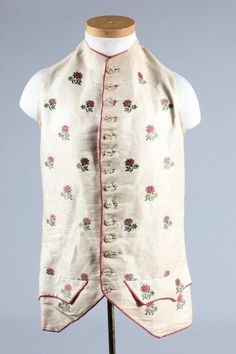 Waistcoat,, 1760-70. Possibly Indian brocade embroidered with floraöl sprays, embroidered buttons and part lined in pink plush.