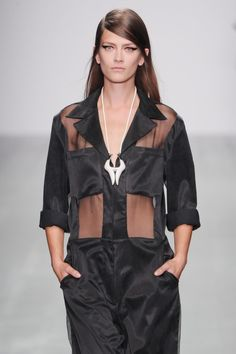 Howdy cowgirl!@JPBraganzakicks off todays shows with this sheer panelled jumpsuit , accessorised with a country and western style necklace. #LFW #SS15