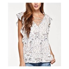 This nod to Spring Love Stitch printed lace up v-neck flutter sleeve top in Vanilla and Grey is so cute!