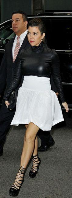 Who made Kourtney Kardashian's black leather turtleneck top, white skirt, black handbag, and white skirt that she wore in New York on January 15, 2013? Shirt – Monika Chiang  Shoes – Alexander McQueen  Skirt – Miu Miu  Purse – Chanel