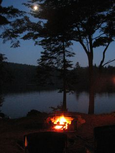 Campfire by the lake at Eighth Lake Campground - NYSDEC Campgrounds