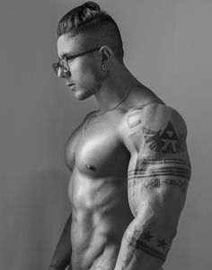 """Wings of Zelda."" Canvas: Andres Vergel's hard biceps. Muscle stamps. Tattoos, body art."