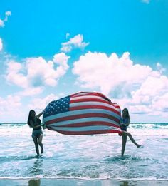 USINMADE | Gorgeous beach shot featuring the American flag.