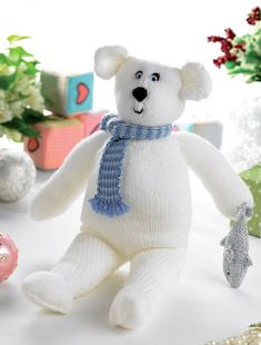 Polar bear free knitting pattern with patterns for scarf and fish | more favorite bear knitting patterns at http://intheloopknitting.com/free-teddy-bear-knitting-patterns/