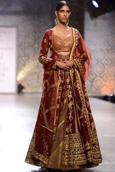 Rimple and Harpreet Narula runway couture 2016 collection online. a marsala cutaway neckline tulle jacket with gold kasab and gota work shikargah motifs. Shop this now at www.carmaonlineshop.com #ICW2016 #carmaonlineshop #indian #designer #Rimple&Harpreet #ethnic #heritage #India #craft #lehenga #wedding #sequin #zardozi #embroidery #whimsical #shimmer #couture #shopnow #shoponline