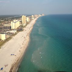 Flying over Panama City Beach/Gulf of Mexico in a helicopter!!!I will be here this winter for 4 months.