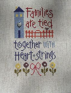 completed cross stitch Lizzie Kate Friends are tied together with heart string