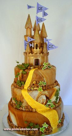 "This 3-tier castle cake was created for an ""Enchanted Forest"" themed Sweet 16 party."