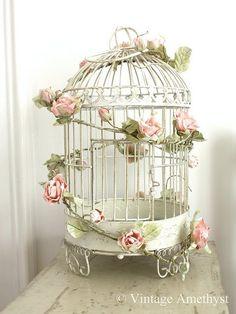 diy vintage wedding bird cage   pink garland on birdcage