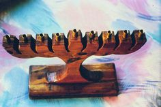 Hand-carved wooden menorah by Jerry Pokras.