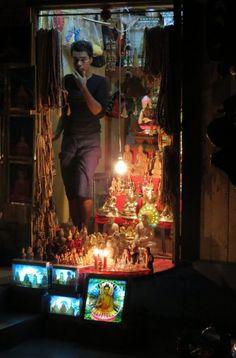 Stall holder Shwedagon Pagoda entrance Yangon, Myanmar